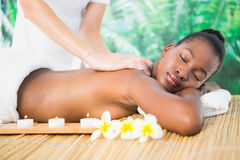 Pretty woman enjoying a massage Royalty Free Stock Images