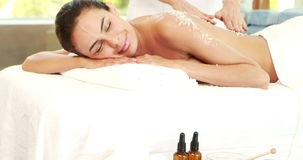 Pretty woman enjoying a salt scrub massage stock footage