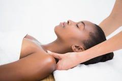 Pretty woman enjoying a shoulder massage Stock Images