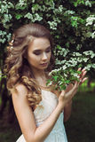 Pretty woman enjoying smell flowers Stock Image