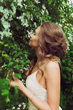 Pretty woman enjoying smell flowers Royalty Free Stock Image