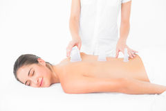 Pretty woman enjoying suction massage. At the health spa Stock Image