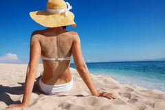 Pretty woman enjoying vacation on beach Stock Images