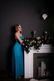 Pretty woman in evening dress posing over dark background Royalty Free Stock Photography