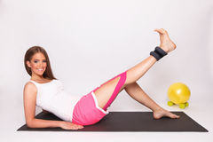 Pretty woman exercise with taped injured leg Stock Photo
