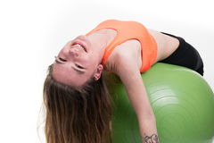 Pretty Woman exercising pilates ball workout posture. Isolated Stock Photography