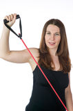 Pretty woman exercising with a rubber band Royalty Free Stock Photography