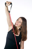 Pretty woman exercising with a rubber band Stock Photography