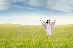 Pretty woman with fabric running on meadow. Portrait of beautiful young woman running on the meadow while holding fabric, shot at springtime Royalty Free Stock Photos