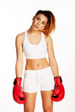 Pretty woman with fallen arms and boxing gloves Royalty Free Stock Photo