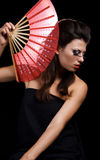 Pretty woman with fan Stock Images