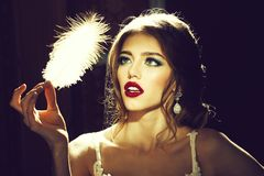 Pretty woman with feather closeup royalty free stock images