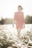 Pretty woman in feather-grass field Royalty Free Stock Photos