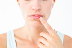 Pretty woman with finger on lip Royalty Free Stock Photos