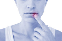 Pretty woman with finger on lip Stock Images