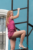 Pretty woman on fire escape stair Royalty Free Stock Photography