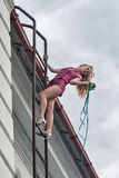Pretty woman on fire escape stair Royalty Free Stock Image