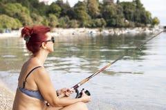 Pretty woman fishing Stock Photo