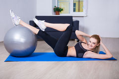 Pretty woman with fit ball at home Stock Photography