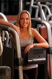 Pretty woman in fitness center