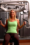 Pretty woman in fitness center Royalty Free Stock Image