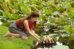 Pretty woman in floating flower joist. Pretty Thai woman in Thai style clothes floating flower joist Stock Photos