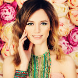 Pretty Woman on Floral Background Stock Photography