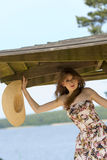 Pretty woman in floral dress near lake Royalty Free Stock Images