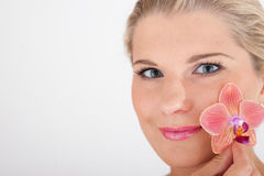 Pretty woman with a flower Stock Photos