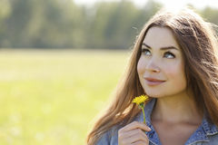 Pretty woman with flower Royalty Free Stock Photography