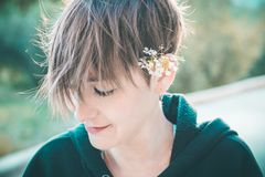 Pretty woman with a flower in her ear stock photography