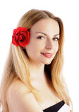 Pretty woman with flower in her hair Stock Photos