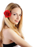 Pretty woman with flower in her hair Stock Photo