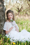 Pretty woman with flower in park Stock Photography