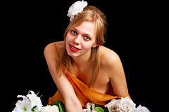 Pretty woman with flowers Royalty Free Stock Photography
