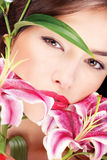 Pretty woman with flowers Royalty Free Stock Image