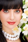Pretty woman with flowers royalty free stock photo