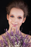 Pretty Woman with Flowers on Black Background Royalty Free Stock Images