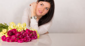 Pretty woman with flowers Stock Image