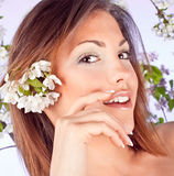 Pretty woman with flowers in hair Stock Photos