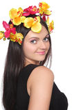 Pretty woman with flowers on head Stock Photo