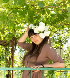 Pretty woman with flowers in her hair Stock Photo