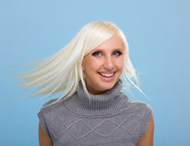 Pretty woman with flying blond hair Royalty Free Stock Photo
