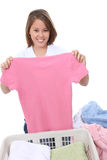 Pretty Woman Folding Clothes Royalty Free Stock Image