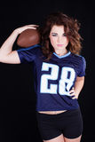 Pretty woman with football Stock Images