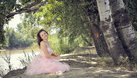 Pretty woman in forest in spring time Royalty Free Stock Images
