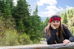 Pretty woman in a forested valley Stock Images