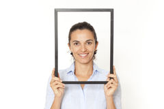 Pretty woman with a frame Royalty Free Stock Photos