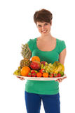 Pretty woman with fresh fruit Stock Photos