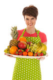 Pretty woman with fresh fruit Stock Images